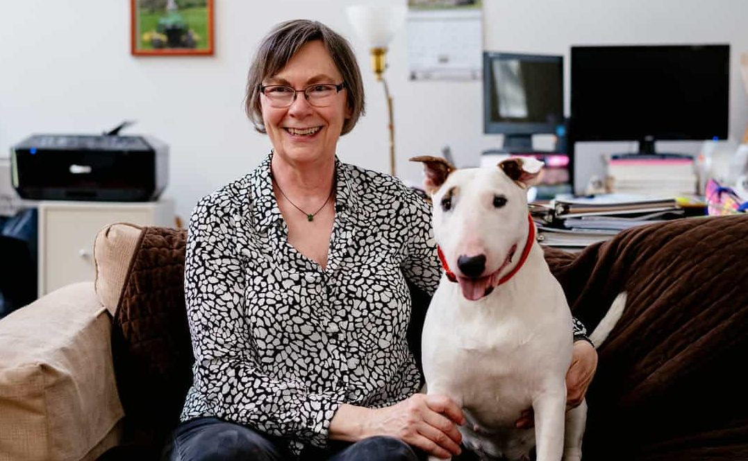 Woman and Bull Terrier on Sofa